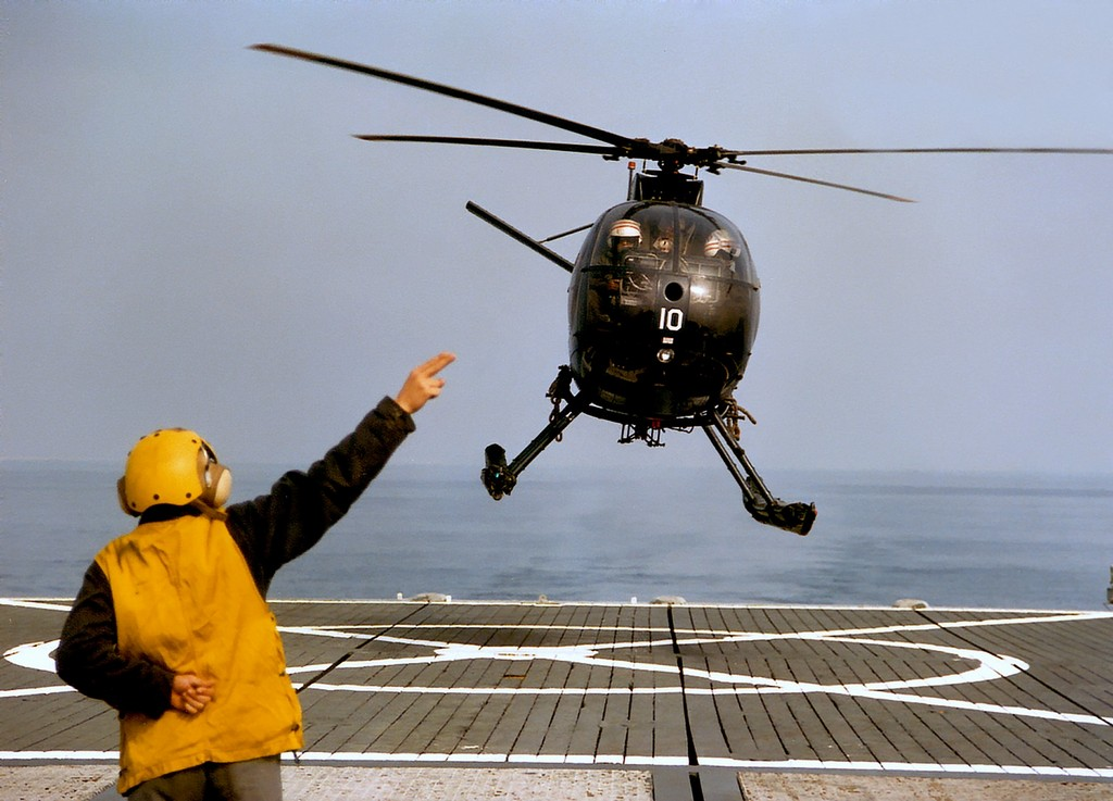 H-500 taking off from a flight deck