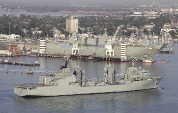 The 'Cantabria' arriving at Melbourne with the LHD 'Canberra' in the background. (RAN photograph)