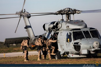 Marines boarding a Navy helicopter