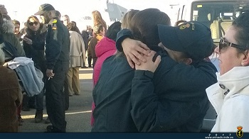 Family members bidding farewell to the ship's crew.