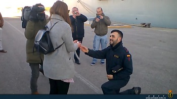 A sailor proposing marriage to his girlfriend.