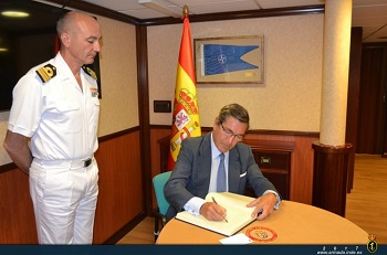 The Ambassador signing in the ship's Guest Book