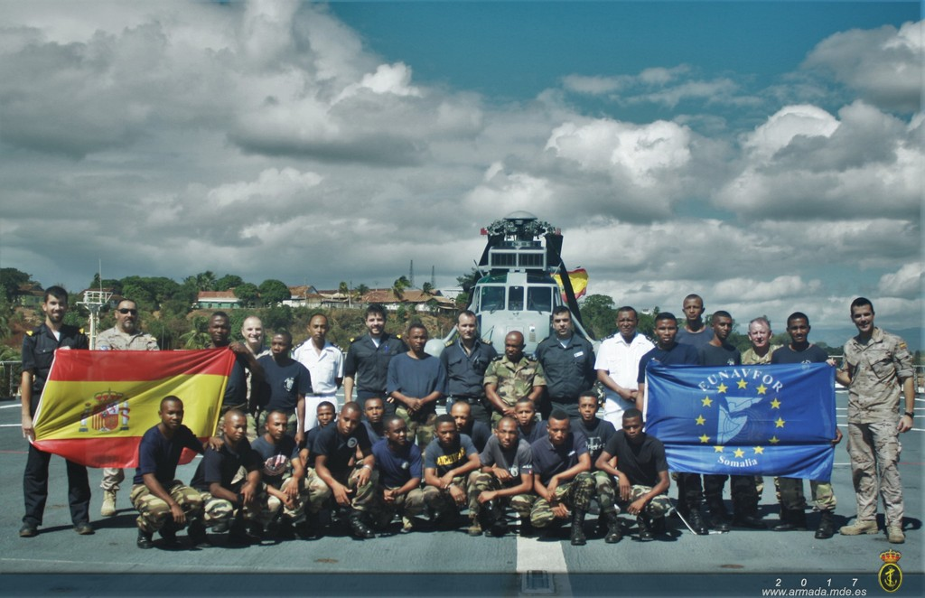 Spanish and Malagasy servicemen on the ship's flight deck