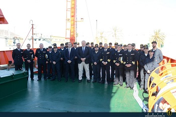 Military and civilian authorities bidding farewell to the ship